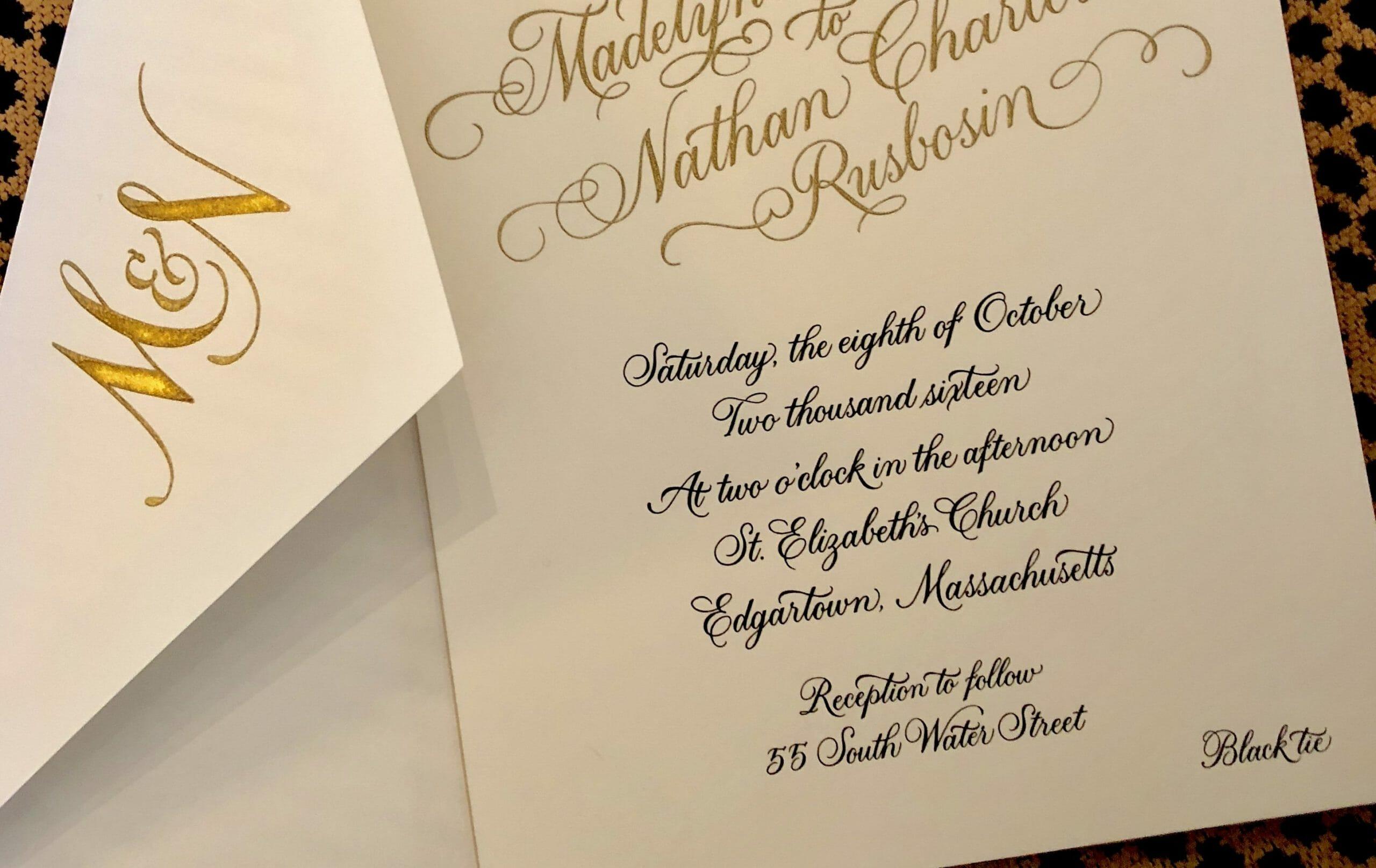 Close-up of elegant cursive fonts on wedding invitation
