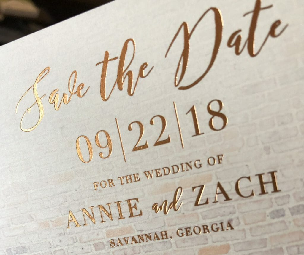 Close-up of Save the Date with gold ink