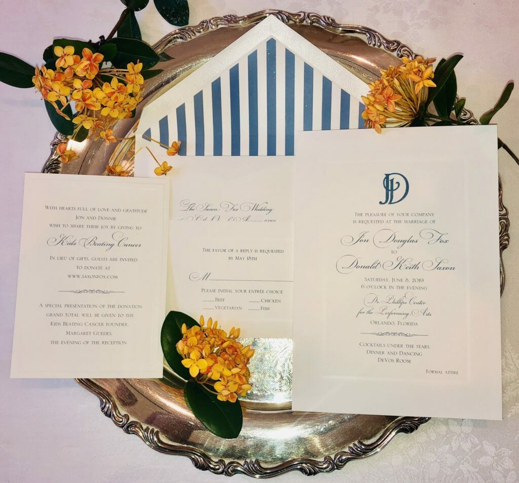 Matching wedding invitation, RSVP card, information card, and envelope with blue and white vertically striped liner