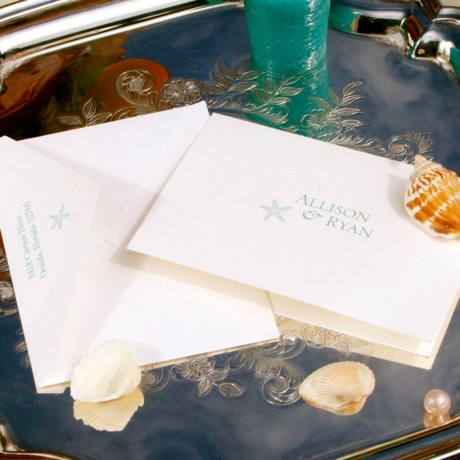 Simple personalized stationery on cream colored card stock with name and starfish printed in blue ink