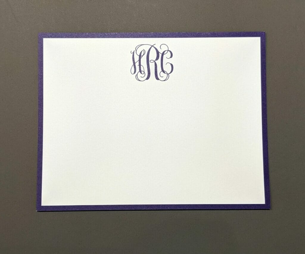 Simple personalized stationery with blue monogram at top and blue border