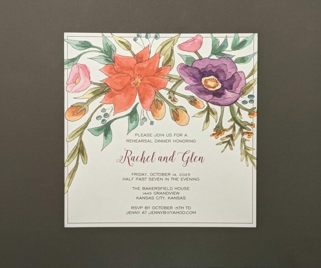 Almost square rehearsal dinner invitation with large flowers adorning the top and a thin border close to the edge