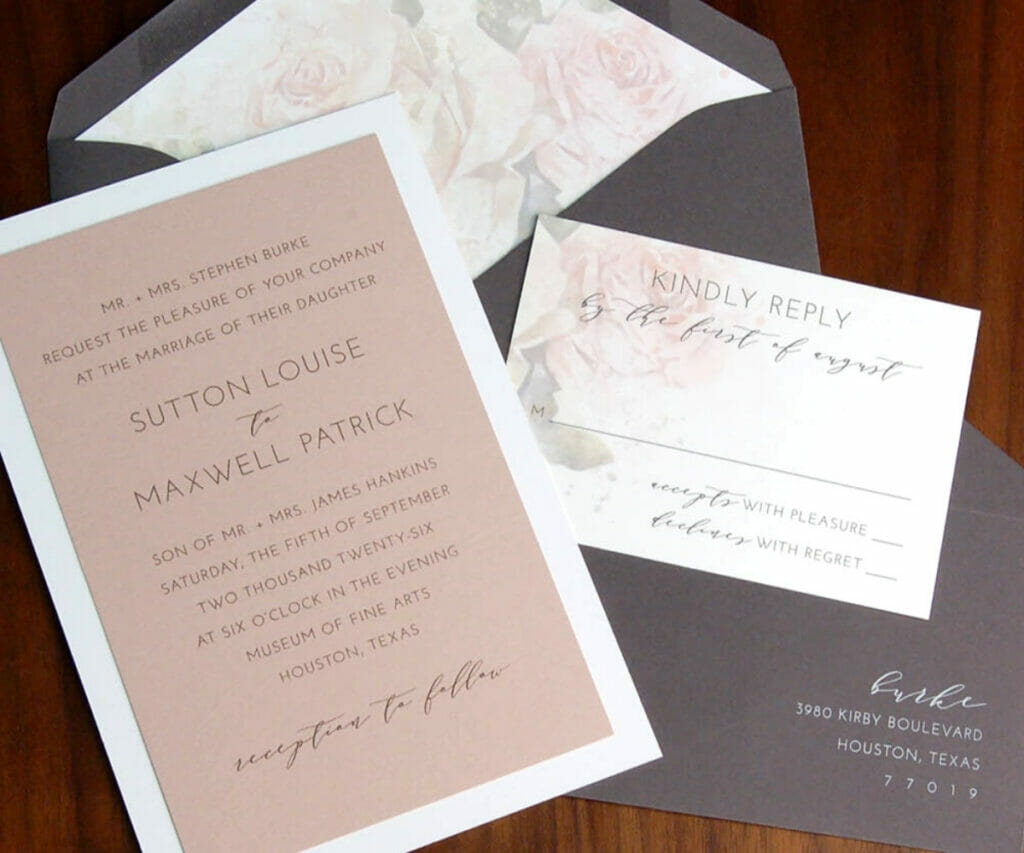 Wedding invitation on pink paper and RSVP card with faint floral background and gray envelopes with floral liner