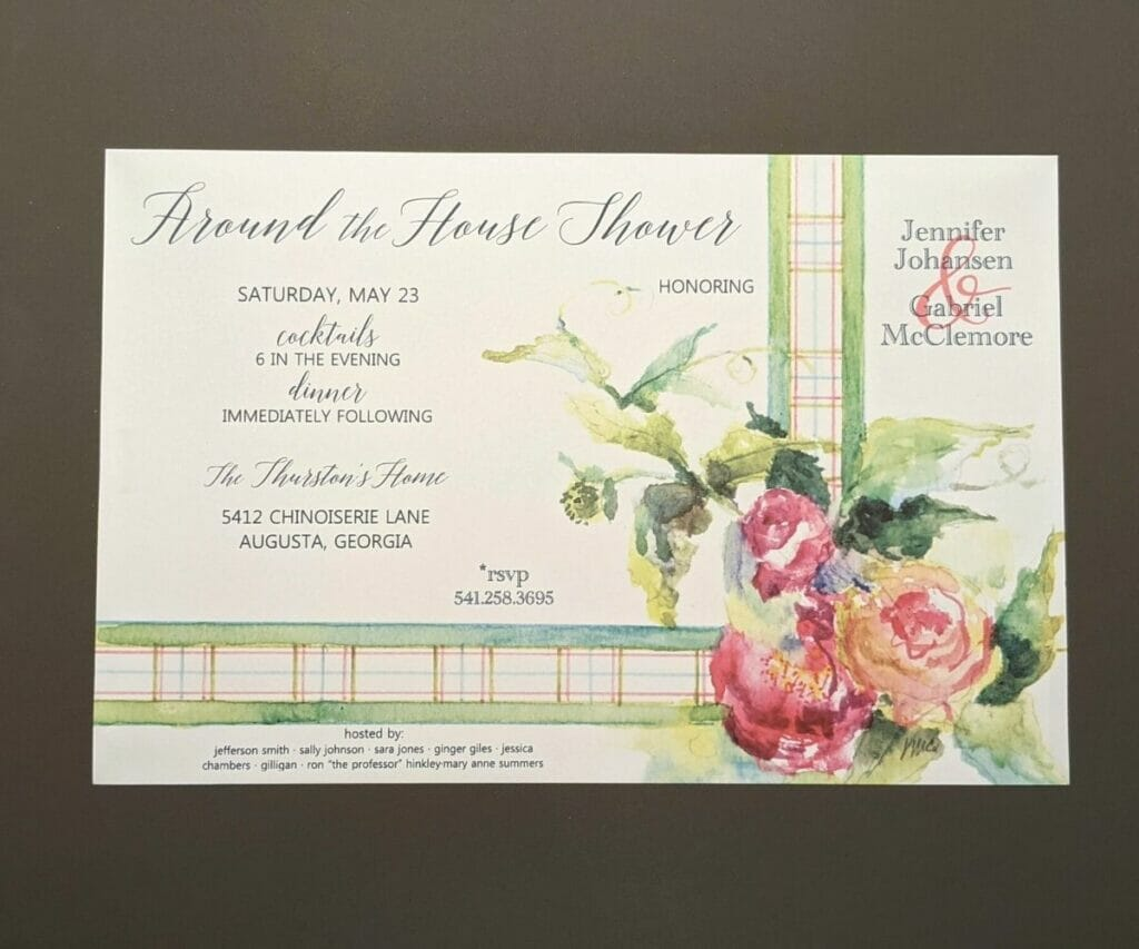 Shower invitation with pastel ribbon as border on bottom and right sides and group of flowers in the bottom right corner