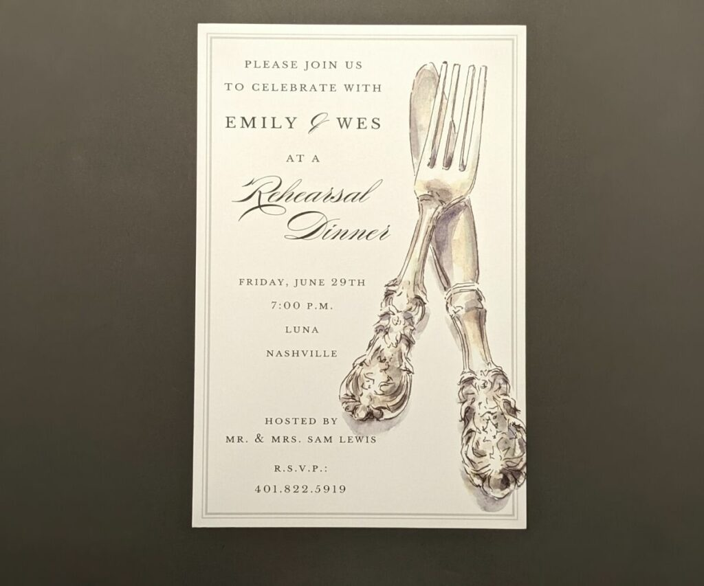 Rehearsal dinner invitation with large watercolor of fancy fork and knife on the right hand side