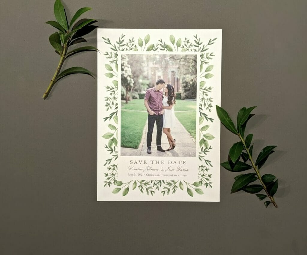 Save the Date Card featuring a photo of the couple and a border of leaves