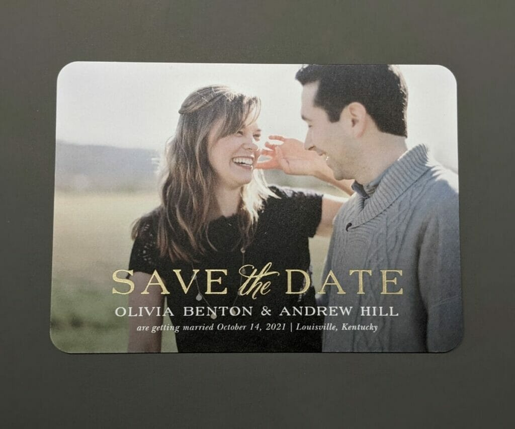 Save the date card with picture of the couple as the background