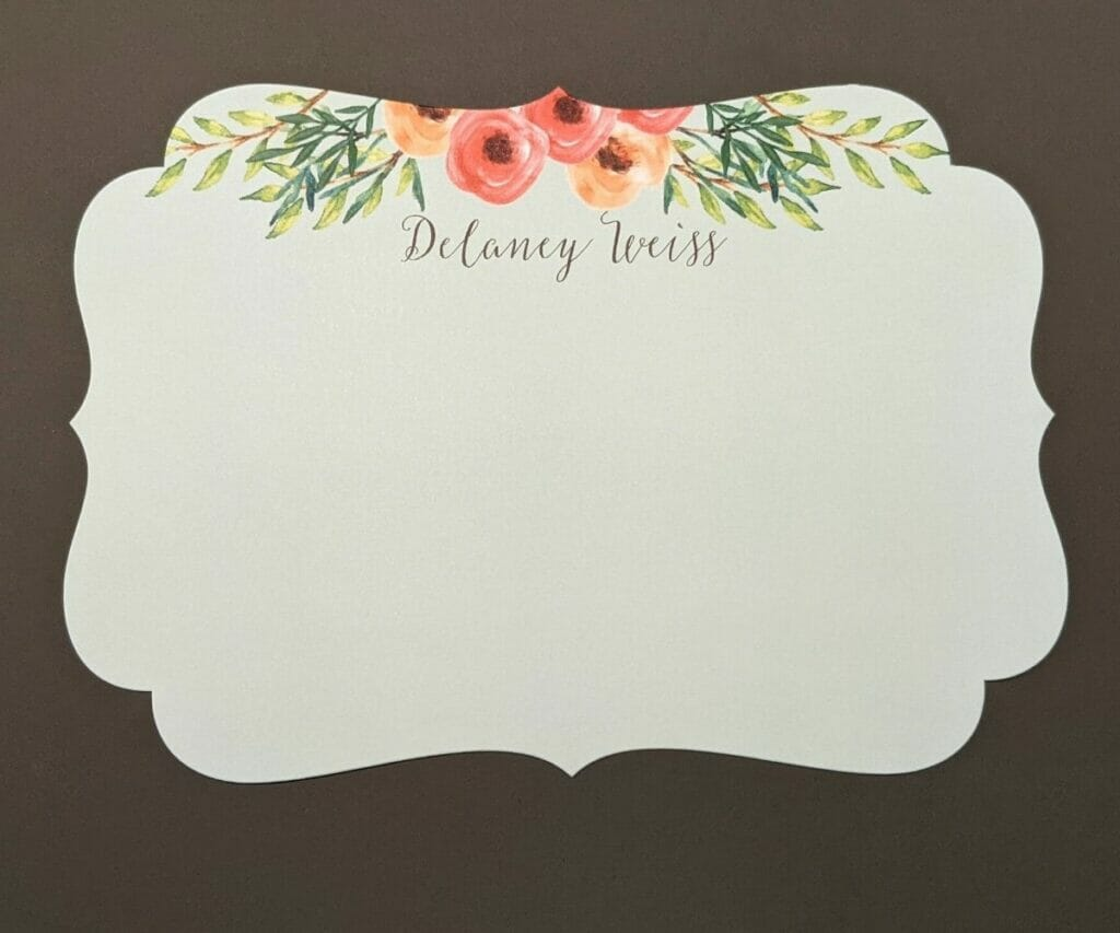 Scalloped personal stationery card with flowers above name at top