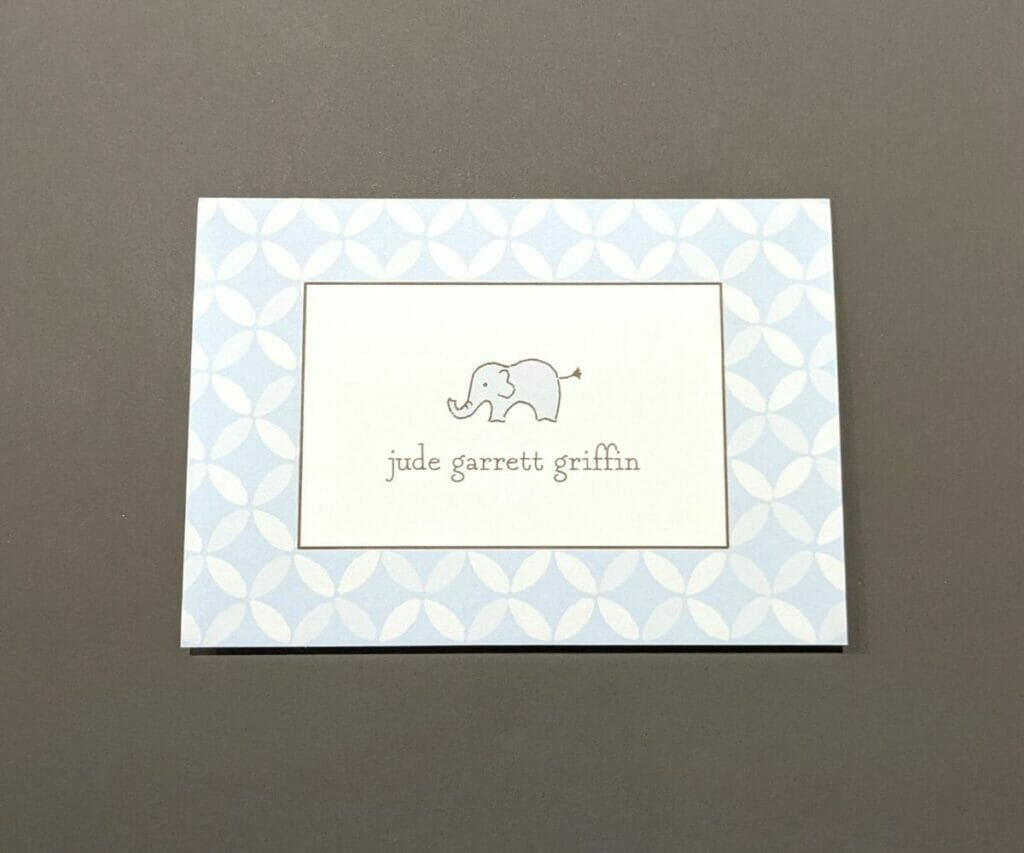Personalized stationery with cute elephant drawing above name in the middle and light blue diamond border around edge