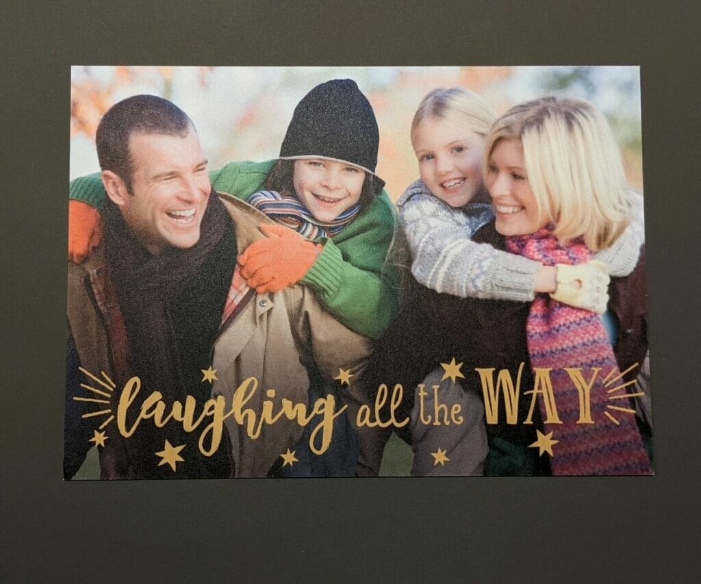 """Laughing All The Way"" photo holiday card of family of four"