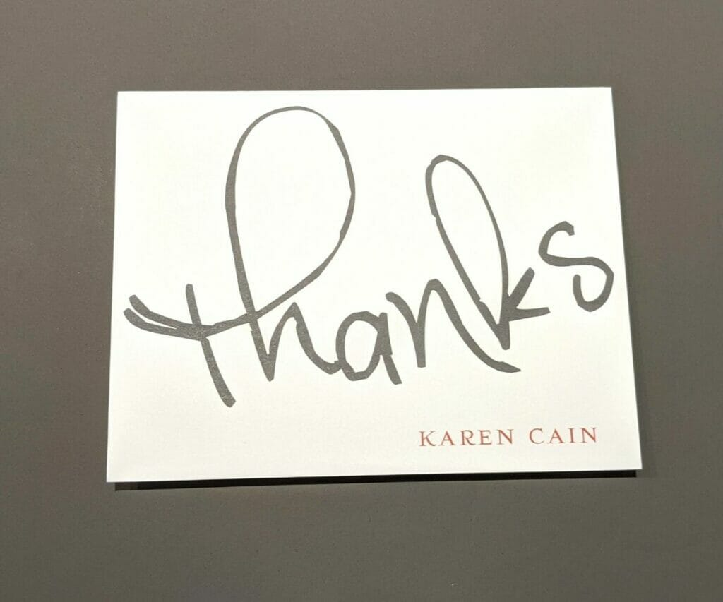 """Thank you note with large """"Thanks"""" in gray cursive and personalized name on front"""